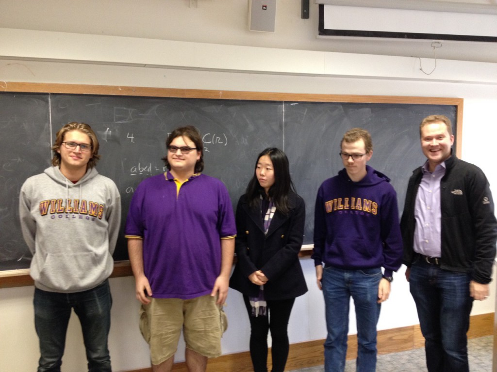 Winning Williams team of Gregory Kehne (41/60), Sam Donow (37/60), Zhiqi Li (44/60) and Granger Carty (57/60). Faculty advisors Eyvindur Ari Palsson and Frank Morgan (behind the camera).